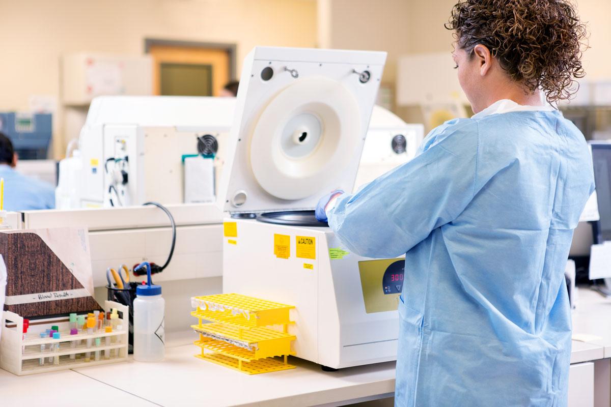 Scientist Using Pcr Machine In Lab